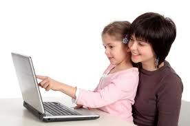 mother and daughter using the computer to find information